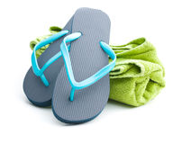 Flip flops and towel. Isolated on white background stock images