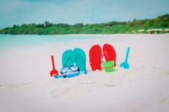 Flip flops, toys and diving mask at beach. Flip flops, toys and diving mask at tropical beach Stock Image