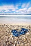 Flip flops on tropical beach Stock Images