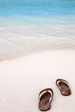 Flip-flops  on a tropical beach Stock Photo