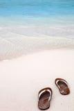 Flip-flops on a tropical beach. Flip-flops on the white sands of a tropical beach stock photo