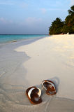 Flip-flops  on a tropical beach. Flip-flops on the white sands of a tropical beach Royalty Free Stock Photography