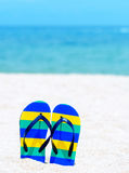 Flip flops on a tropical beach Stock Image