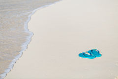 Flip flops on a tropical beach Royalty Free Stock Photo