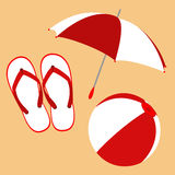 Flip flops, umbrella and ball Stock Photos