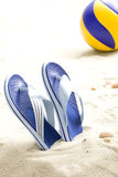 Flip-flops and volleyball ball Stock Images