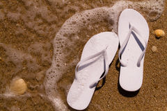 Flip Flops in the water Stock Photography