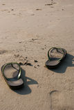 Flip flops on white sand on the beach Royalty Free Stock Photography