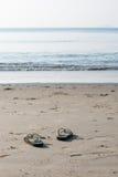 Flip flops on white sand on the beach Stock Photos