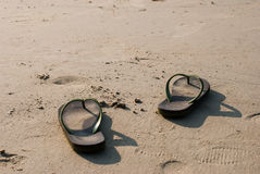 Flip flops on white sand on the beach Royalty Free Stock Images