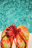 Flip Flops on white towel pool Royalty Free Stock Photography