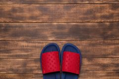Flip flops on wooden background royalty free stock photo
