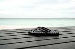 Flip-flops on wooden decking Royalty Free Stock Photos
