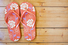 flip flops on the wooden floor. Stock Photo