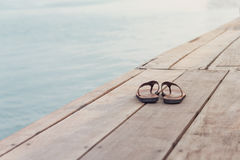 Flip Flops On A Wooden Jetty Royalty Free Stock Image
