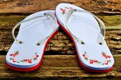 Flip flops on worn wooden floor. Colorfull flip flops on worn wooden floor Stock Image