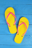 Flip Flops Yellow on blue wooden background Royalty Free Stock Photo