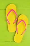 Flip Flops Yellow on green wooden background Royalty Free Stock Photos