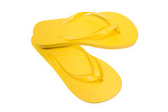 Flip Flops Yellow On White Background. Horizontal shot of bright yellow flip flops on a white background. Copy space Royalty Free Stock Images