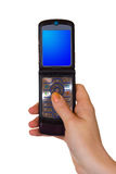 Flip mobile phone in hand. Isolated on white background royalty free stock image