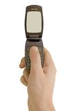 Flip phone in hand. Isolated on white background Royalty Free Stock Photography