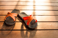 Flipflop. On the deck in the evening light royalty free stock photo