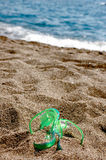 Flipflop in the sand Royalty Free Stock Photos