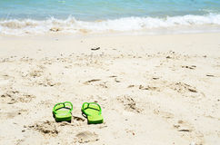 Flipflop sea beach. Flipflop sandals on sea beach royalty free stock image