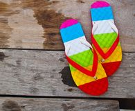 Flipflops. Colorful flip flops on wooden background Royalty Free Stock Photos
