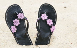 Flipflops at the beach Stock Photography