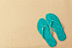 Flipflops on beach. Sand background royalty free stock photo