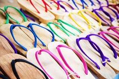 Flipflops on sale, Myanmar. Multi colored flipflops, typical asian open-toed footwear, on market stalls. Myanmar Stock Photos