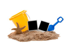 Flipflops, sand, bucket and starfish Royalty Free Stock Photography