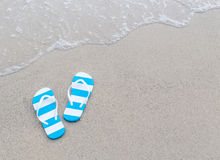 Flipflops on a sand Royalty Free Stock Image