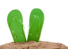 Flipflops in sand on white with copy space Royalty Free Stock Photography