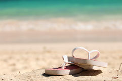Flipflops on a sandy beach. Flipflops on a sandy ocean beach - vacation concept royalty free stock photo