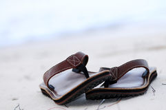 Flipflops on a sandy beach Stock Photography