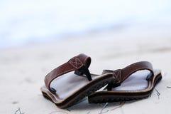 Flipflops on a sandy beach. Flipflops on a sandy ocean beach - summer vacation concept Stock Photography