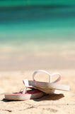 Flipflops on a sandy beach. Flipflops on a sandy ocean beach - vacation concept stock images
