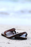 Flipflops on a sandy beach Royalty Free Stock Photos