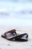 Flipflops on a sandy beach. Flipflops on a sandy ocean beach - summer vacation concept Royalty Free Stock Photos
