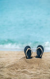 Flipflops on a sandy beach. Summer vacation concept at koh samui,thailand Stock Photography