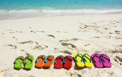 Flipflops on a sandy ocean beach. Royalty Free Stock Photos