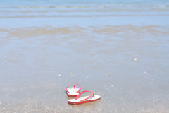 Flipflops on a sandy ocean beach, Vacation concept Royalty Free Stock Photos