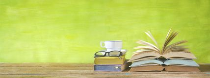 Flipped books, cup of coffee,specs Royalty Free Stock Image