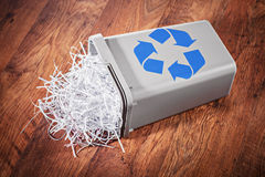 Flipped recycle bin full of shredded paper Royalty Free Stock Photo