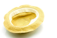 Flipped straw hat. Straw hat isolated on a white background Royalty Free Stock Photo