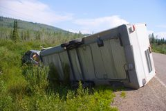 Flipped Trailer. A truck and trailer flip and hit the ditch in the Yukon Territories, Canada royalty free stock photo