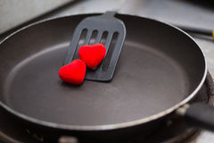 Flipper used in frying with pan and heart Stock Images