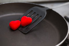 Flipper used in frying with pan and heart Stock Photos